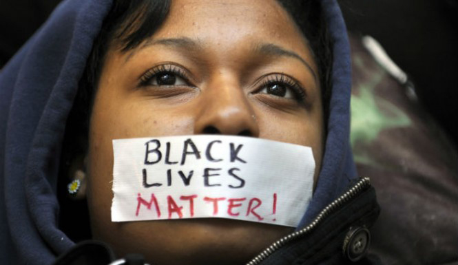 Photo of youth with tape across her mouth that says Black Lives Matter