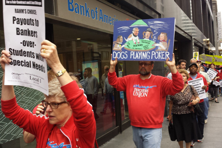 Protesters decry CPS cuts at Bank of America on August 26, 2015.