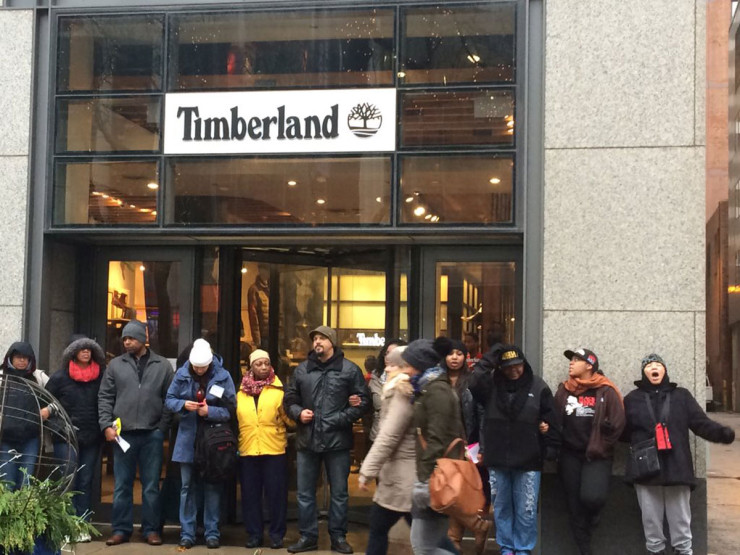 """Protesters blocked stores along Michigan Avenue on """"Black Friday,"""" November 27, 2015, in protest of the fatal shooting of 17-year-old Laquan McDonald by a white police officer."""