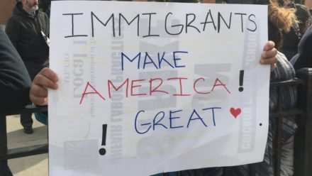 "Handwritten ""Immigrants Make America Great!"" on the back of a CTU picket sign"