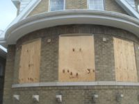 A Chicago bungalow with boarded up windows